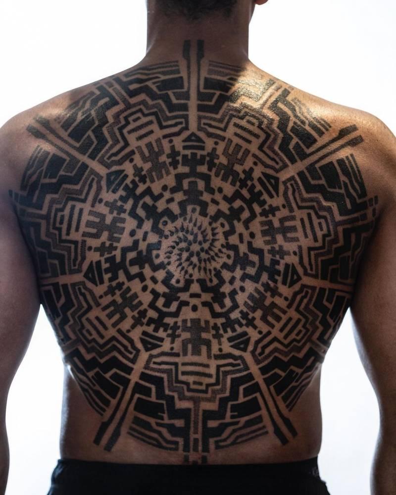 Sacred geometry backpiece tattoo.