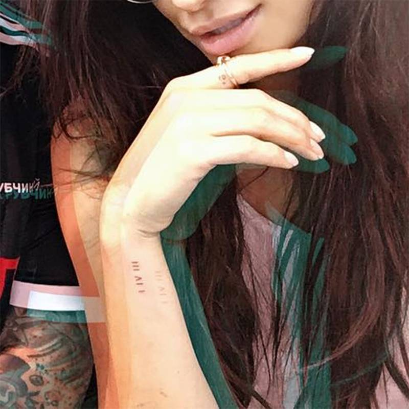 """Shay Mitchell's small tattoo is made up of the Roman numerals for one, four, and three—which typically stands for """"I love you"""" (because of the number of letters in each word)—but she hasn't revealed their meaning yet."""