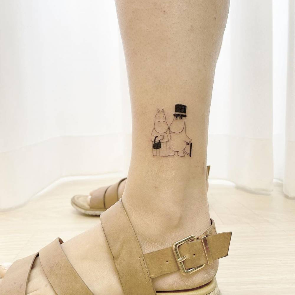 Moomins tattoo on the ankle.