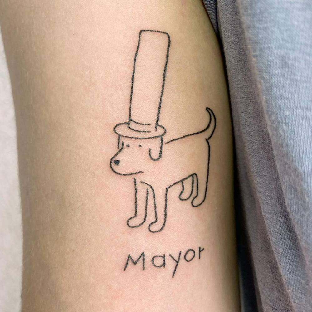 Ignorant style dog tattoo on the bicep.