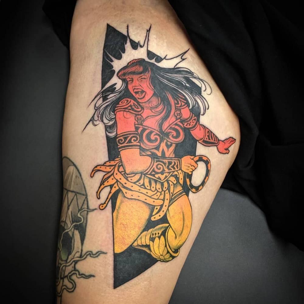 Xena Warrior Princess tattoo on the inner arm.