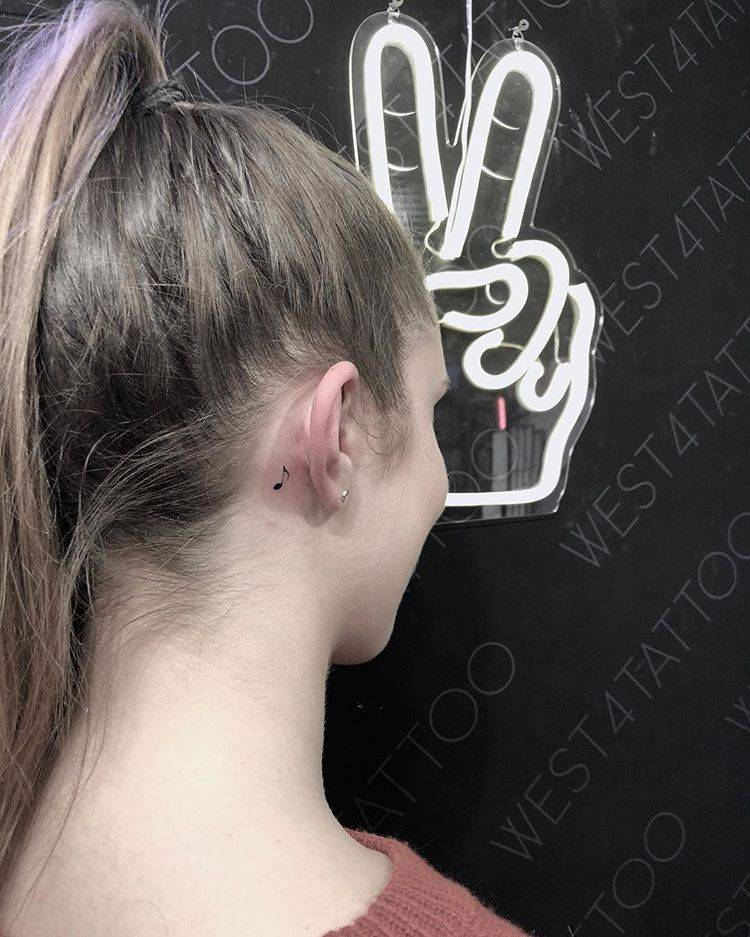 Minimalist Music Note Tattoo Behind The Right Ear