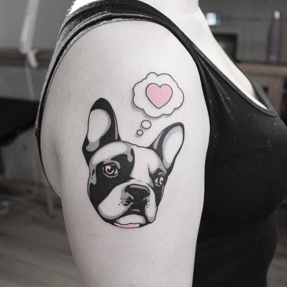 French bulldog tattoo on the right upper arm.