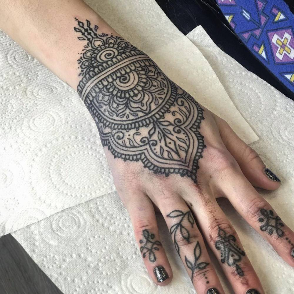 Ornamental Henna tattoo on the hand.