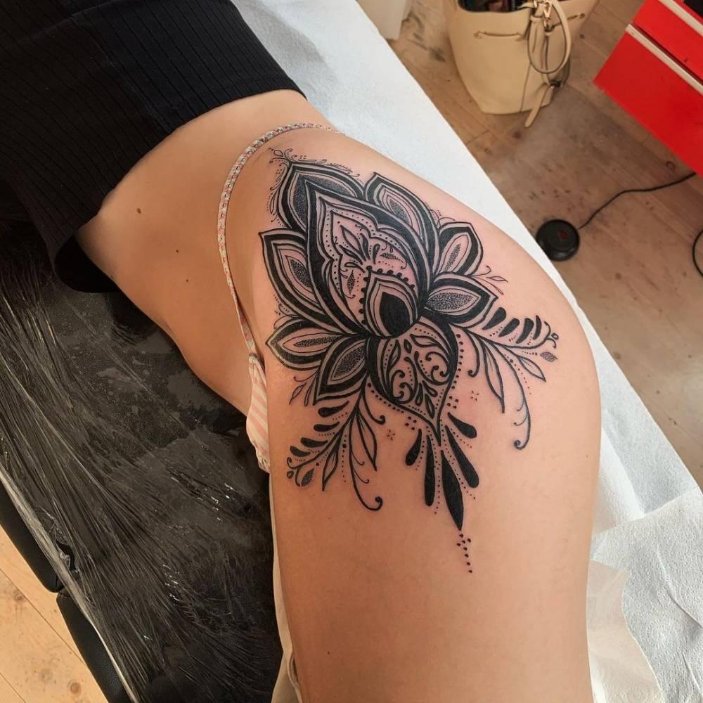 Ornamental lotus flower tattoo on the hip.