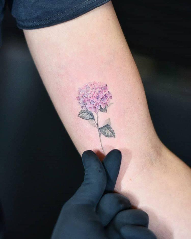 Hydrangea tattoo on the left inner arm.