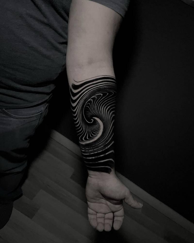 Op art tattoo on the inner forearm.