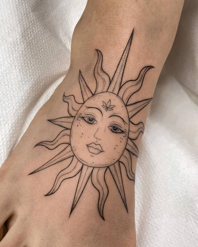 Sun tattoo on the foot.