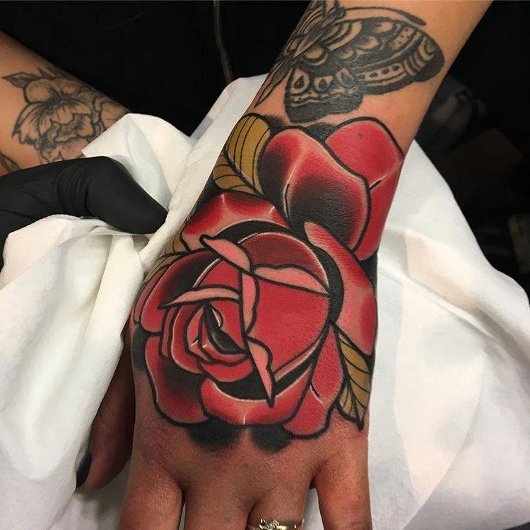 9f5a1b9d5 Traditional red rose tattoo on the left hand.