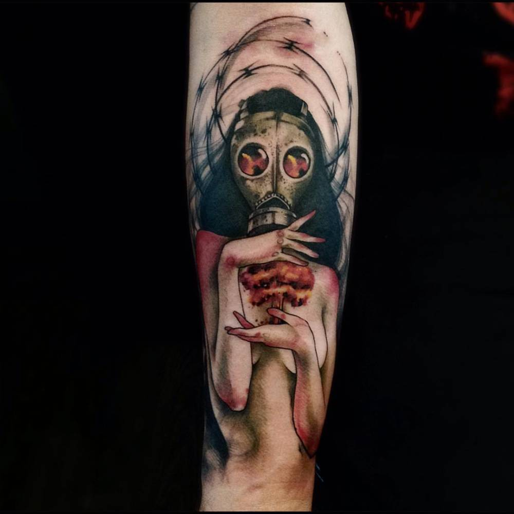 8488f9393d462 Description. Forearm tattoo of a woman using a gas mask ...