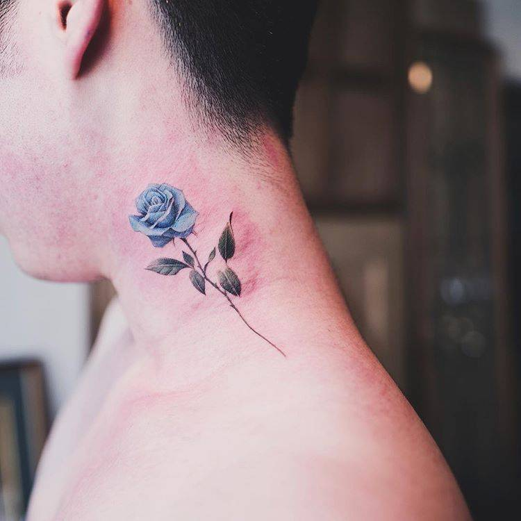 Blue rose tattoo on the left side of the neck.