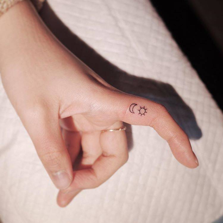 154bdd5d2 Moon and sun tattoo on the finger.