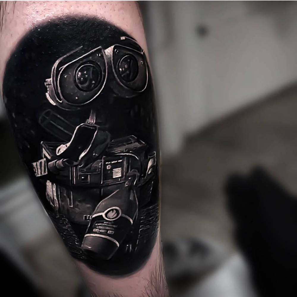 Black and grey Wall-E tattoo on the calf.