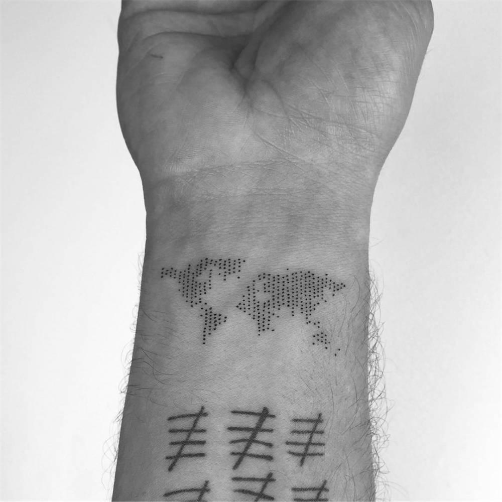 World map tattoo on the inner wrist.