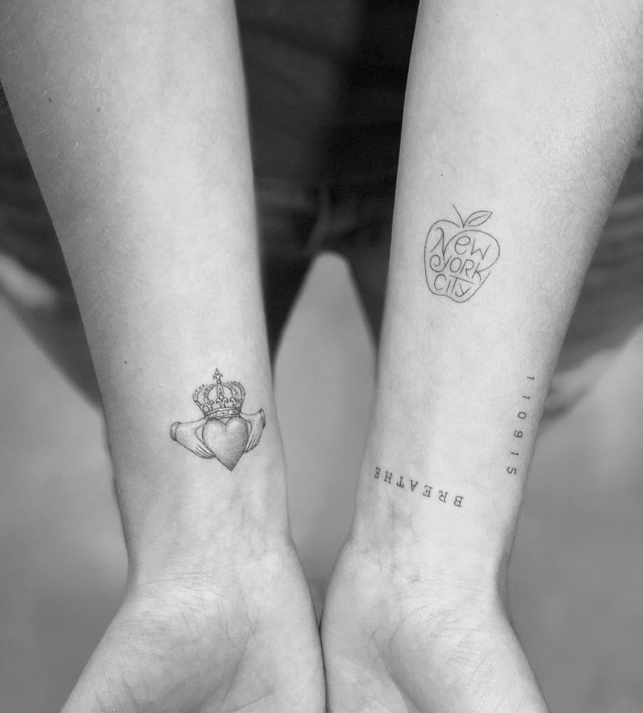 The Irish Claddagh for Grandpa, Breathe, daughter birth date and New York City apple symbol by Nick Slater.