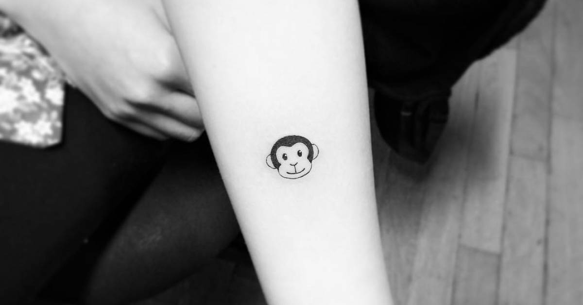small monkey emoji tattoo on the forearm. Black Bedroom Furniture Sets. Home Design Ideas