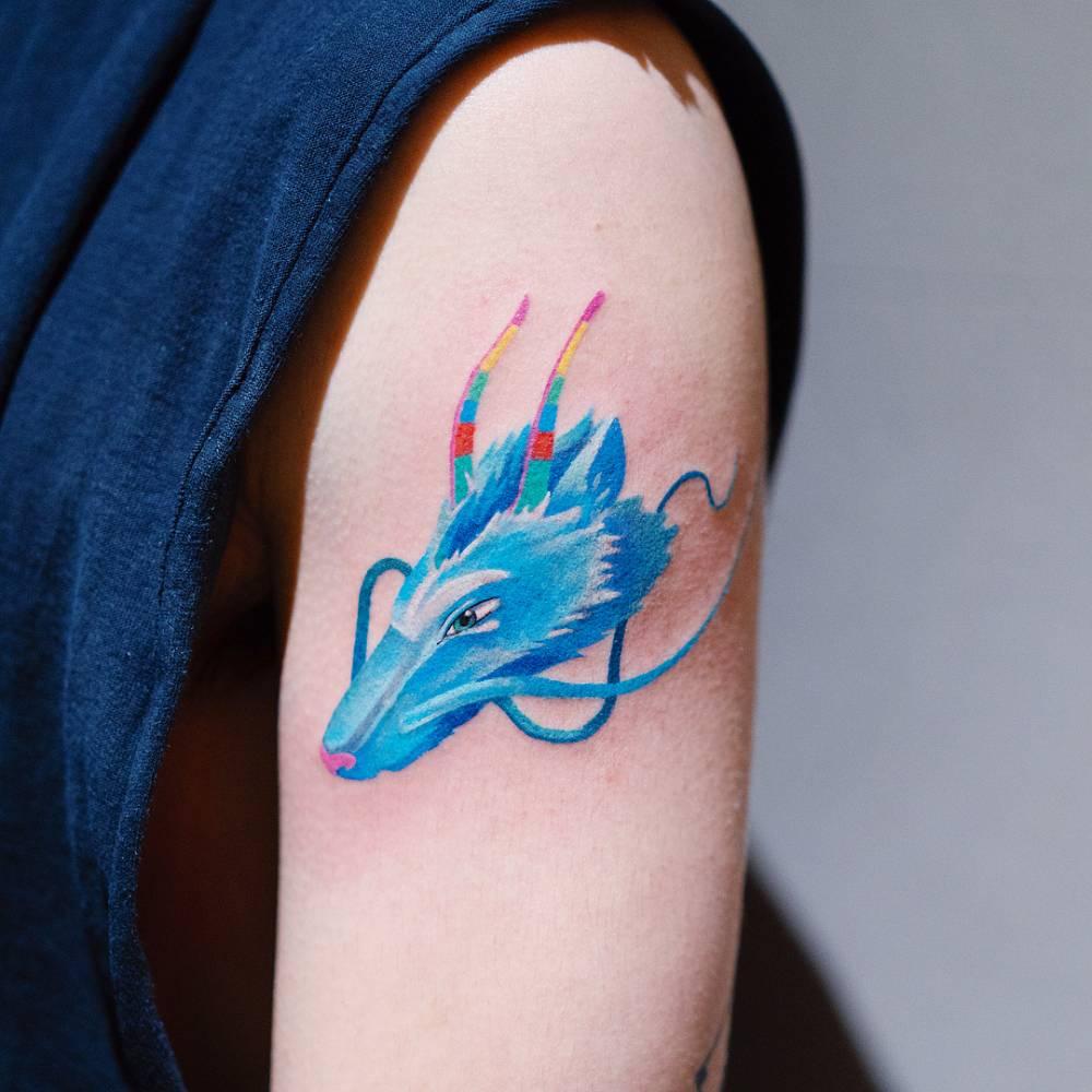 Haku Dragon Head Tattoo On The Upper Arm