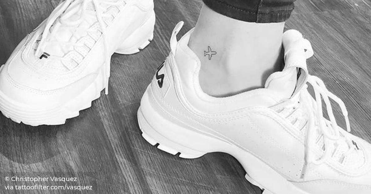 Small Airplane Tattoo On The Ankle