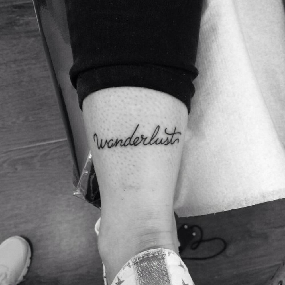 Aquiles Tattoo Saying Wanderlust On Anacelia Romero