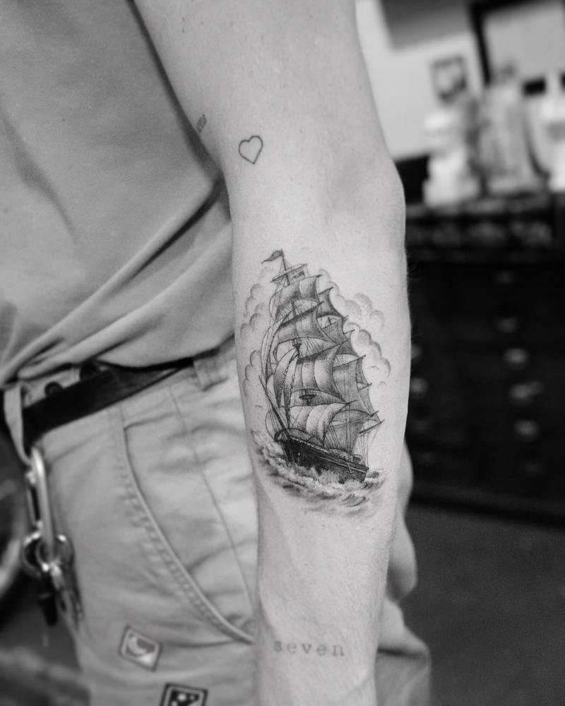 Sailing ship single needle tattoo on the forearm.