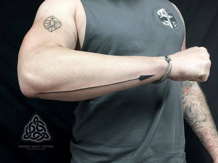 """""""Tarran from Descended from Odin came by the studio yesterday. As you may have guessed from his company name he's Also really into Norse mythology, so we handpoked a Gungnir on his forearm. Gungnir is Odin's spear forged by dwarfs, and had the po"""