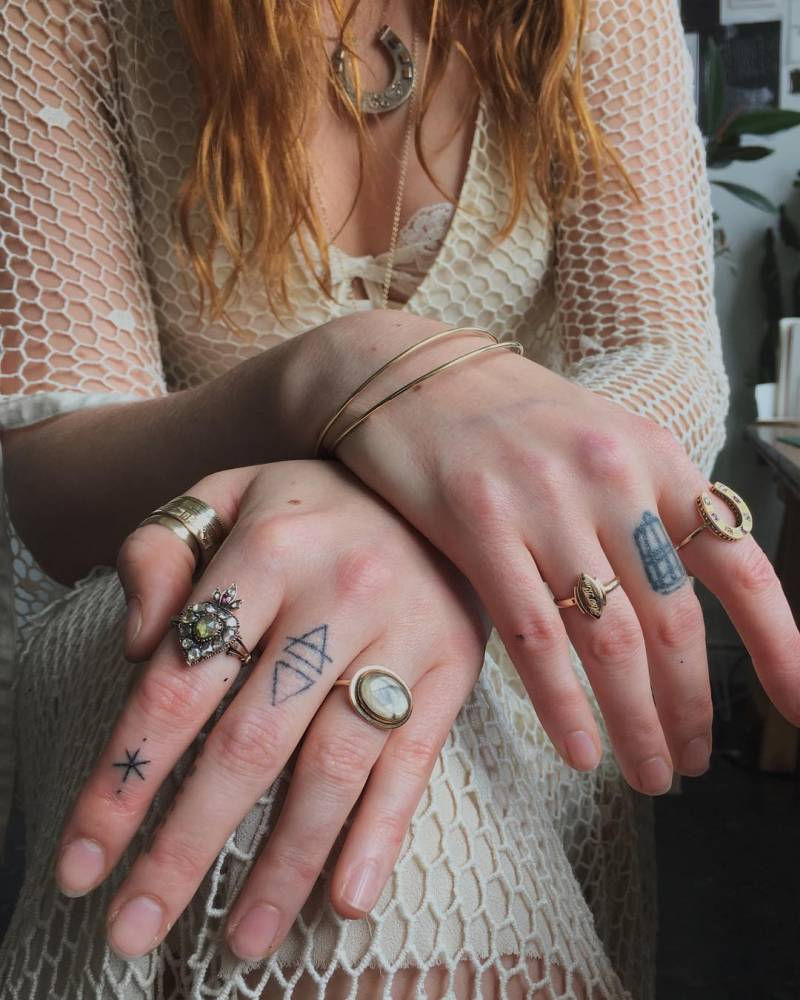 "Small star tattoo on Florence Welch's index finger by Stanislava Pinchuk: ""Home-made tattoos : magic finger for Florence. Traded for boy advice & singing Weeknd songs at the top of her lungs in my studio."""