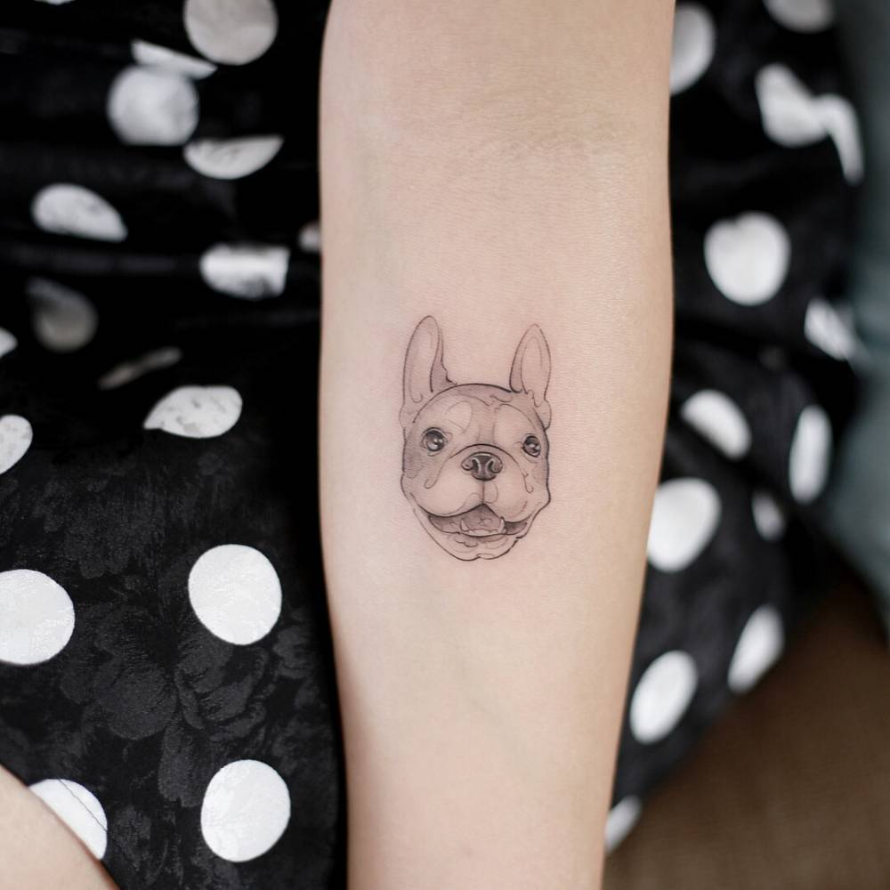 French bulldog tattoo on the inner forearm.