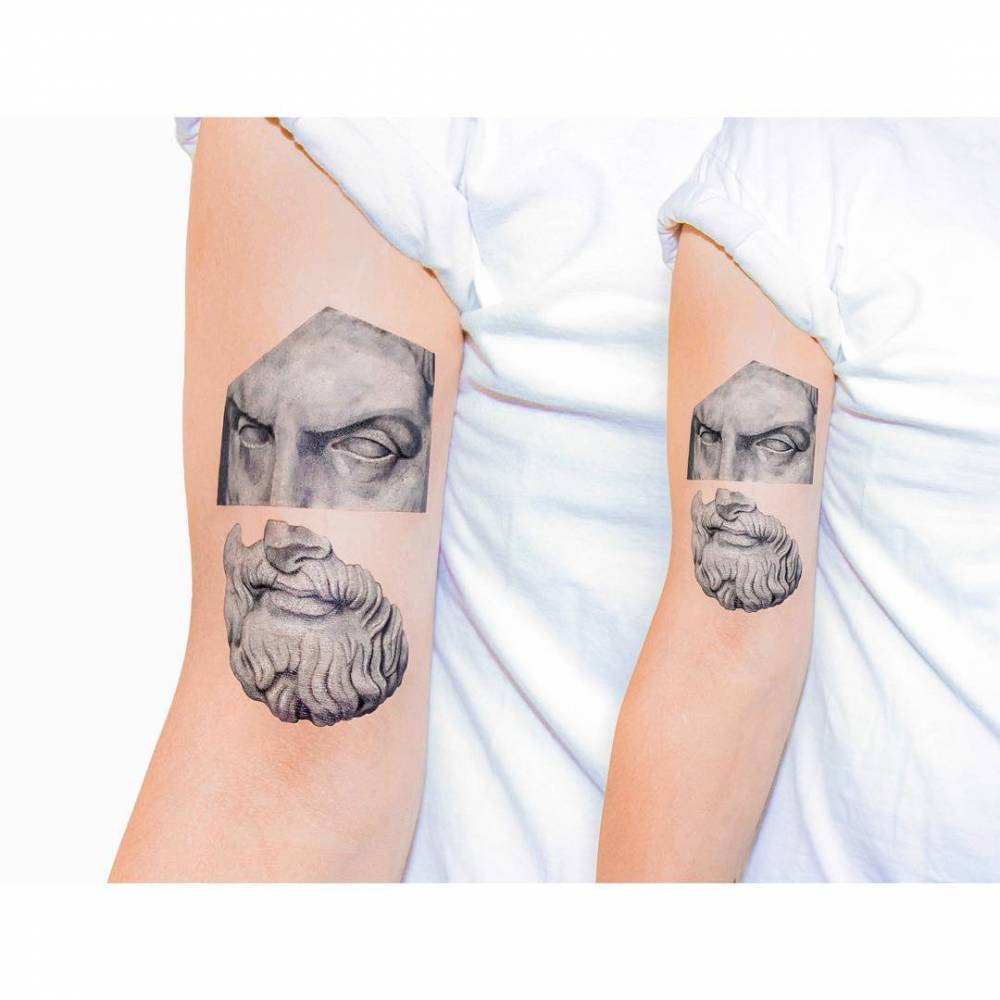Realistic roman sculpture tattoo on the bicep inspired for Greek sculpture tattoo