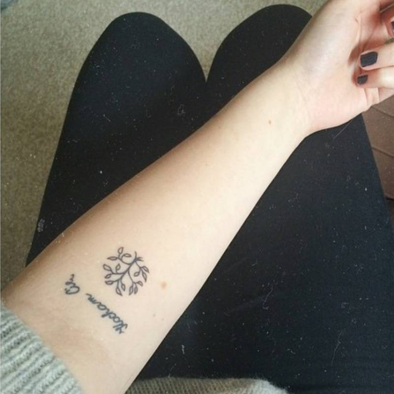 Forearm tattoo on Anna saying \'kocham cie\' (which