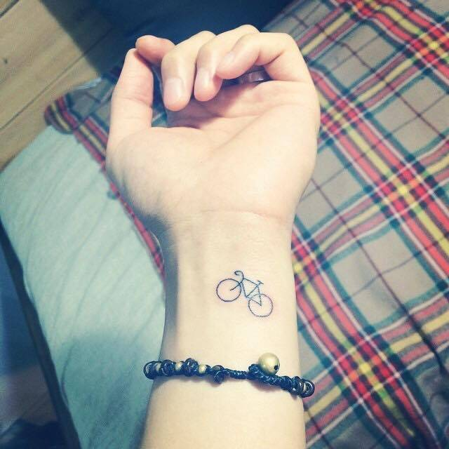 Small Minimalist Bike Tattoo On The Left Inner Wrist