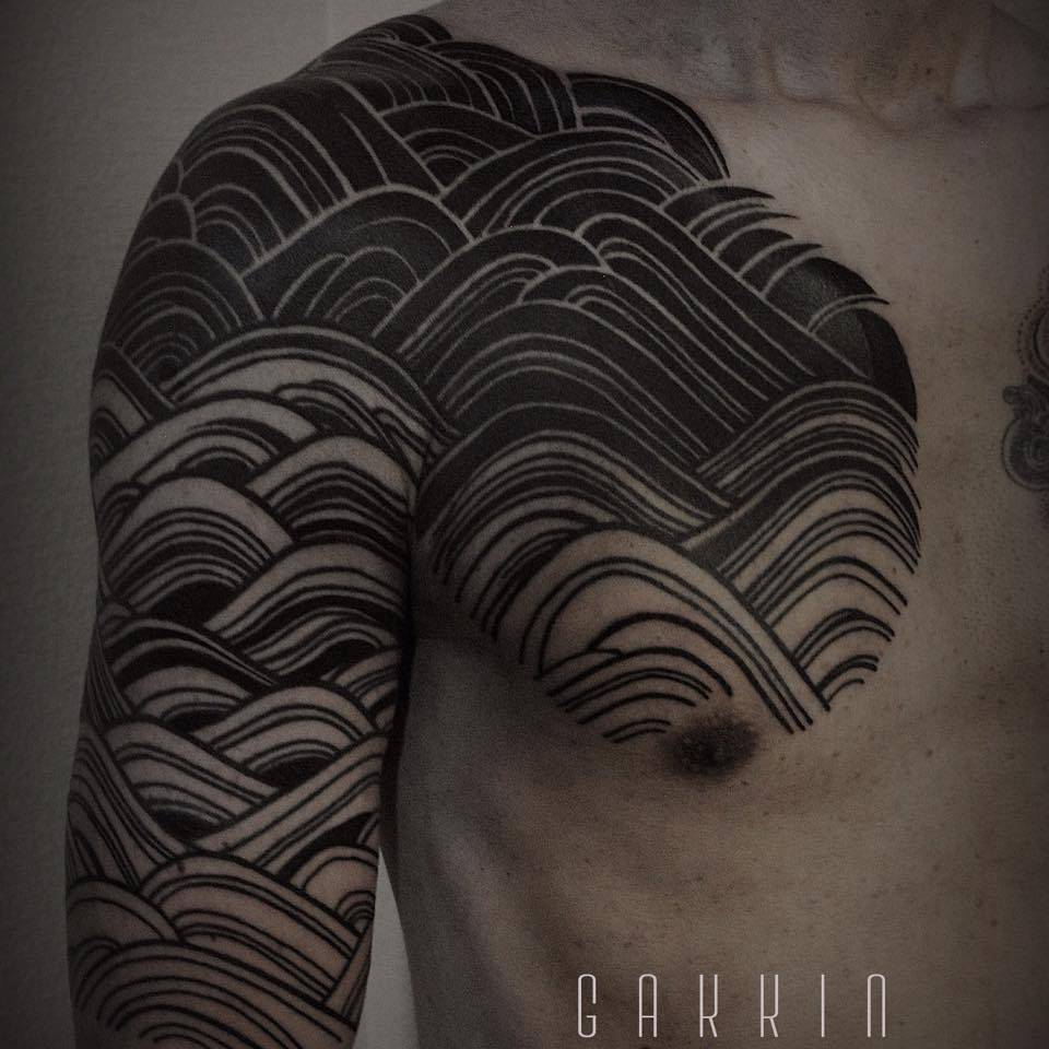 Japanese style pattern tattoo on arm, shoulder and chest.
