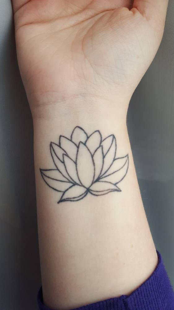 Lotus Flower Tattoo On Emilys Right Wrist Grows Out