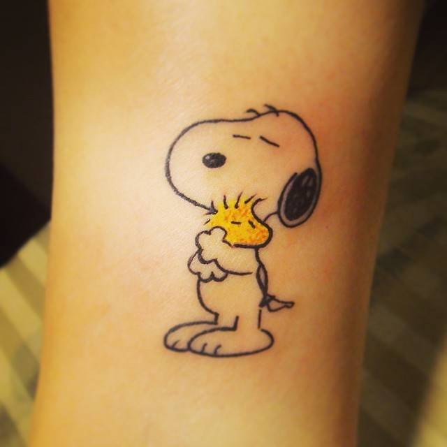 Snoopy And Woodstock Hugging Each Other Tattoo On The
