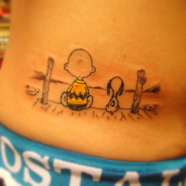 Charlie Brown And Snoopy Tattoo On The Lower Back