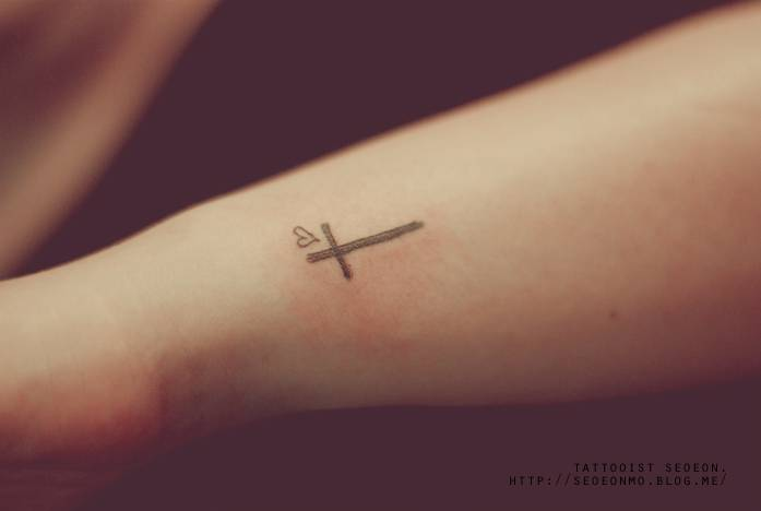 small cross and heart tattoo on the left wrist rh tattoofilter com cross and heart finger tattoo cross and heart tattoo ideas