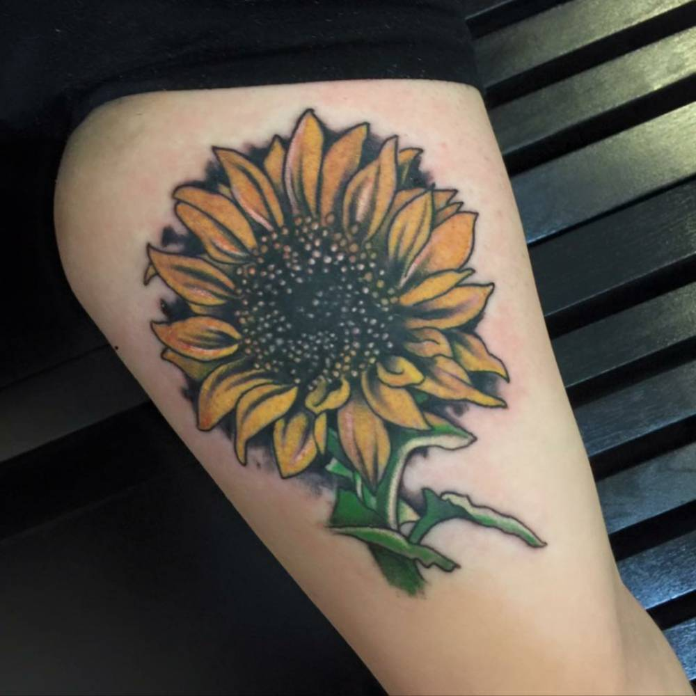 Sun flower tattoo on the left inner arm.