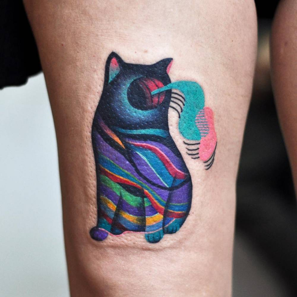 psychedelic cat tattoo on the right thigh. Black Bedroom Furniture Sets. Home Design Ideas