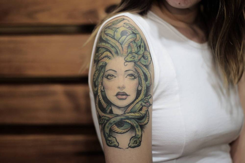 Illustrative Style Medusa Tattoo On The Right Upper Arm