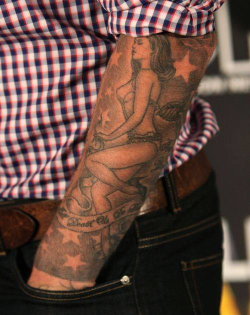 David Beckham's tattoo of Victoria on his left forearm.