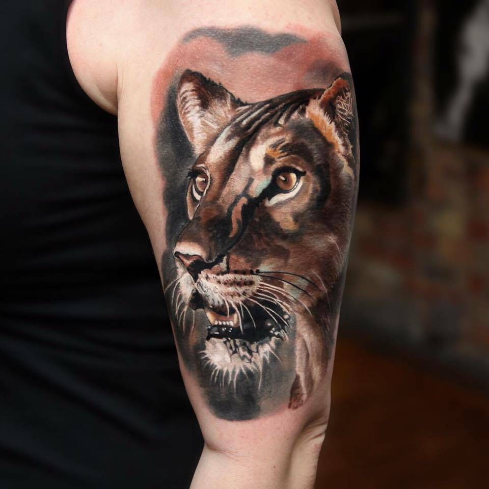 Lioness Tattoos: Realistic Style Lioness Tattoo On The Left Upper Arm
