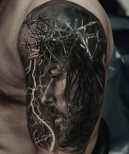 Jesus Christ Portrait Tattoo On The Left Upper Arm And Most often jesus is pictured on the cross. jesus christ portrait tattoo on the