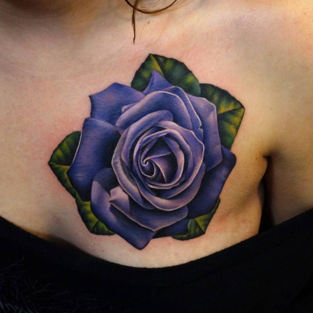 Realistic purple rose tattoo on the left side of the