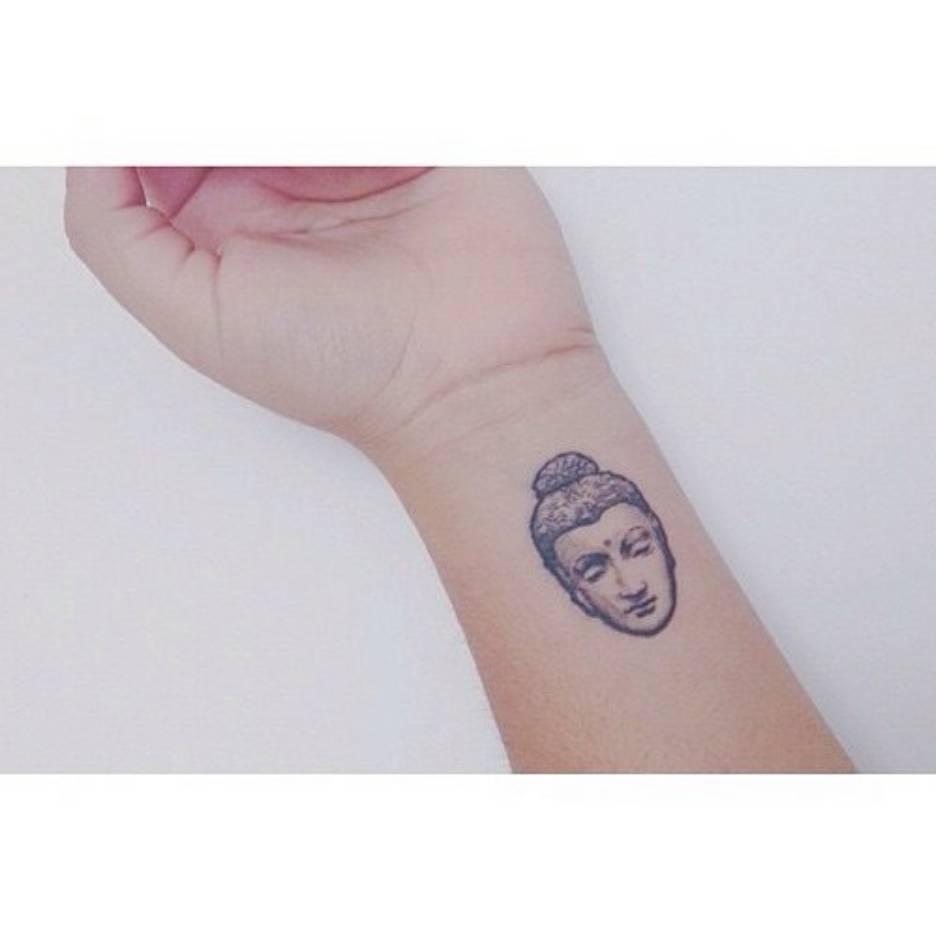 Little Wrist Tattoo Of The Buddha On Daniela Gautama