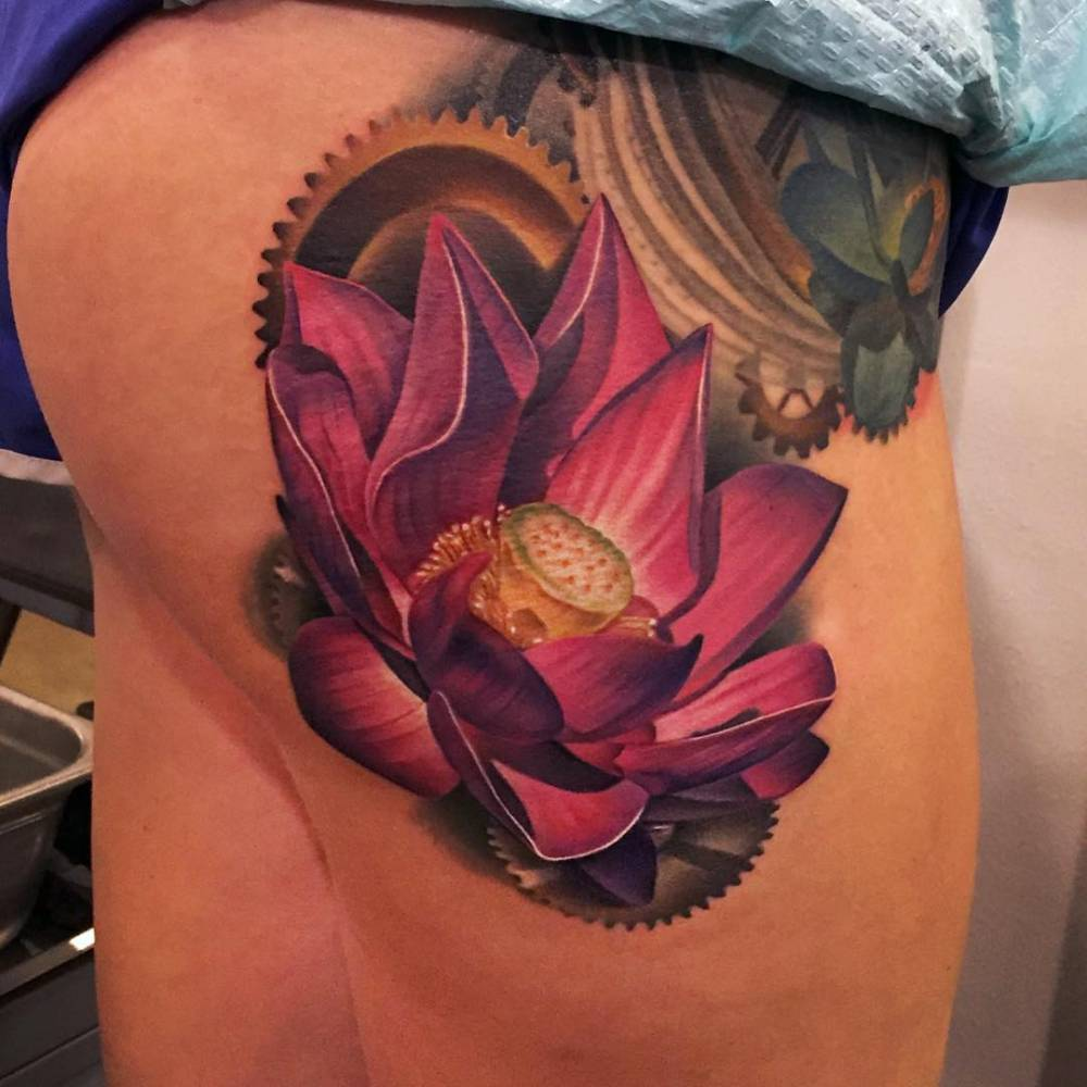 Realistic lotus flower and gears on the side of the realistic lotus flower and gears on the side of the thigh izmirmasajfo