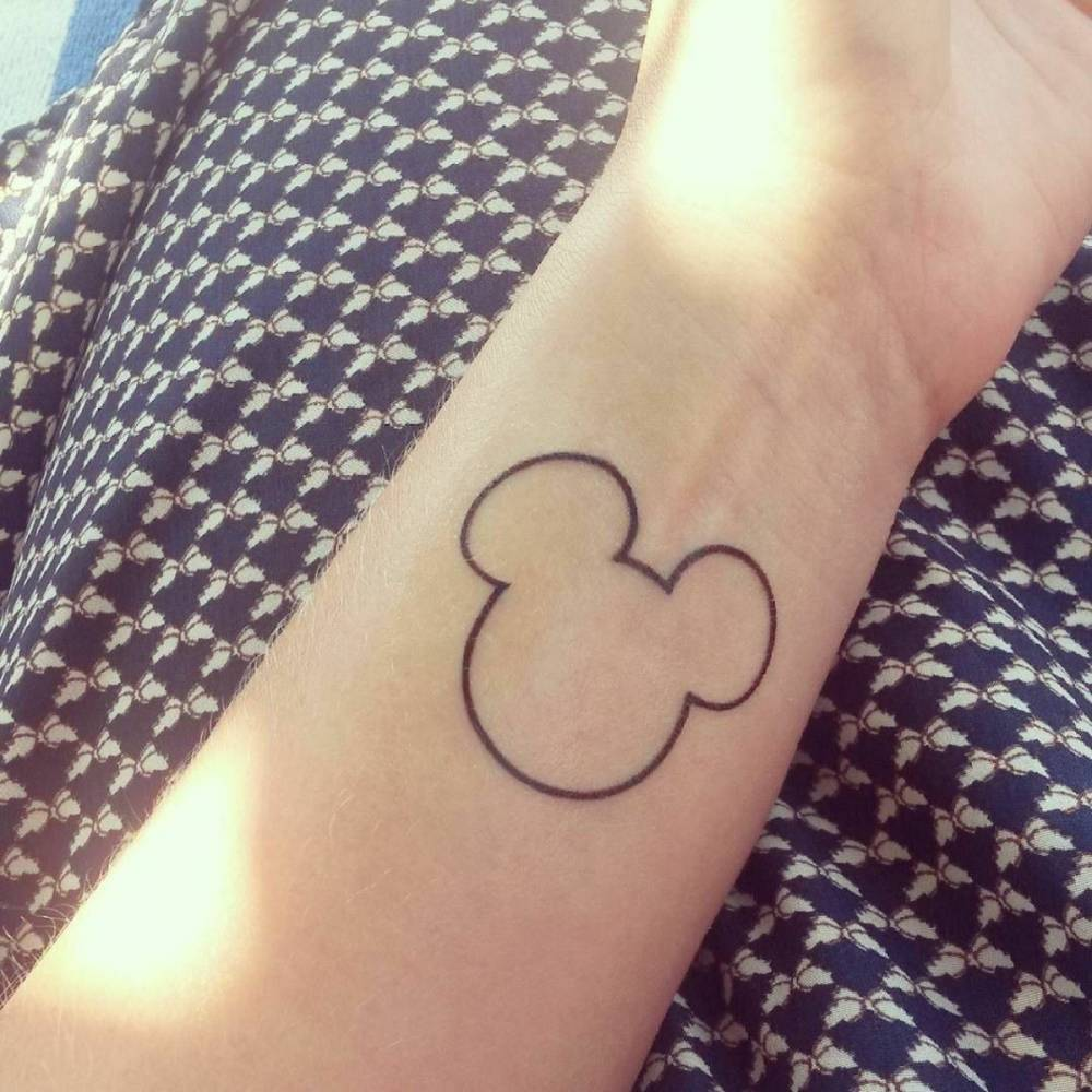 Forearm Tattoo Of Mickey Mouses Shape On Justine