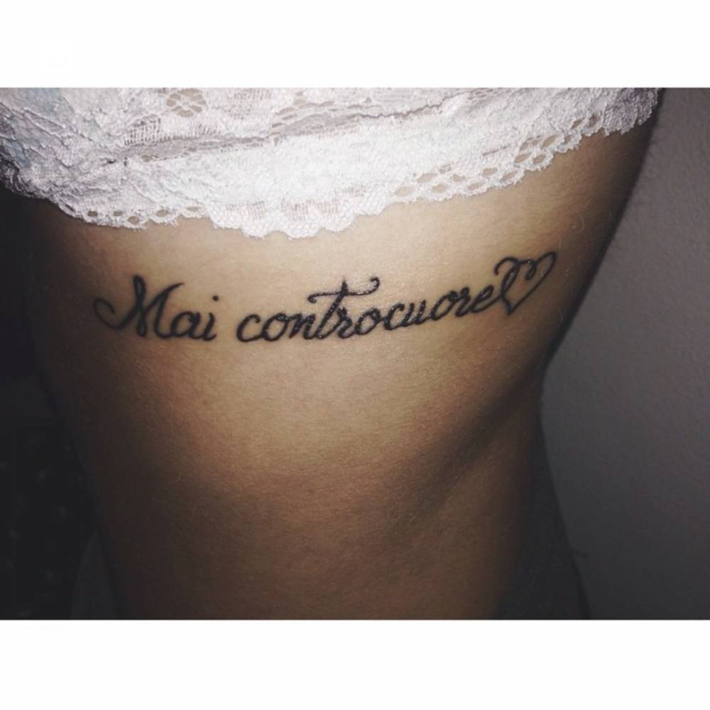 Side tattoo saying \