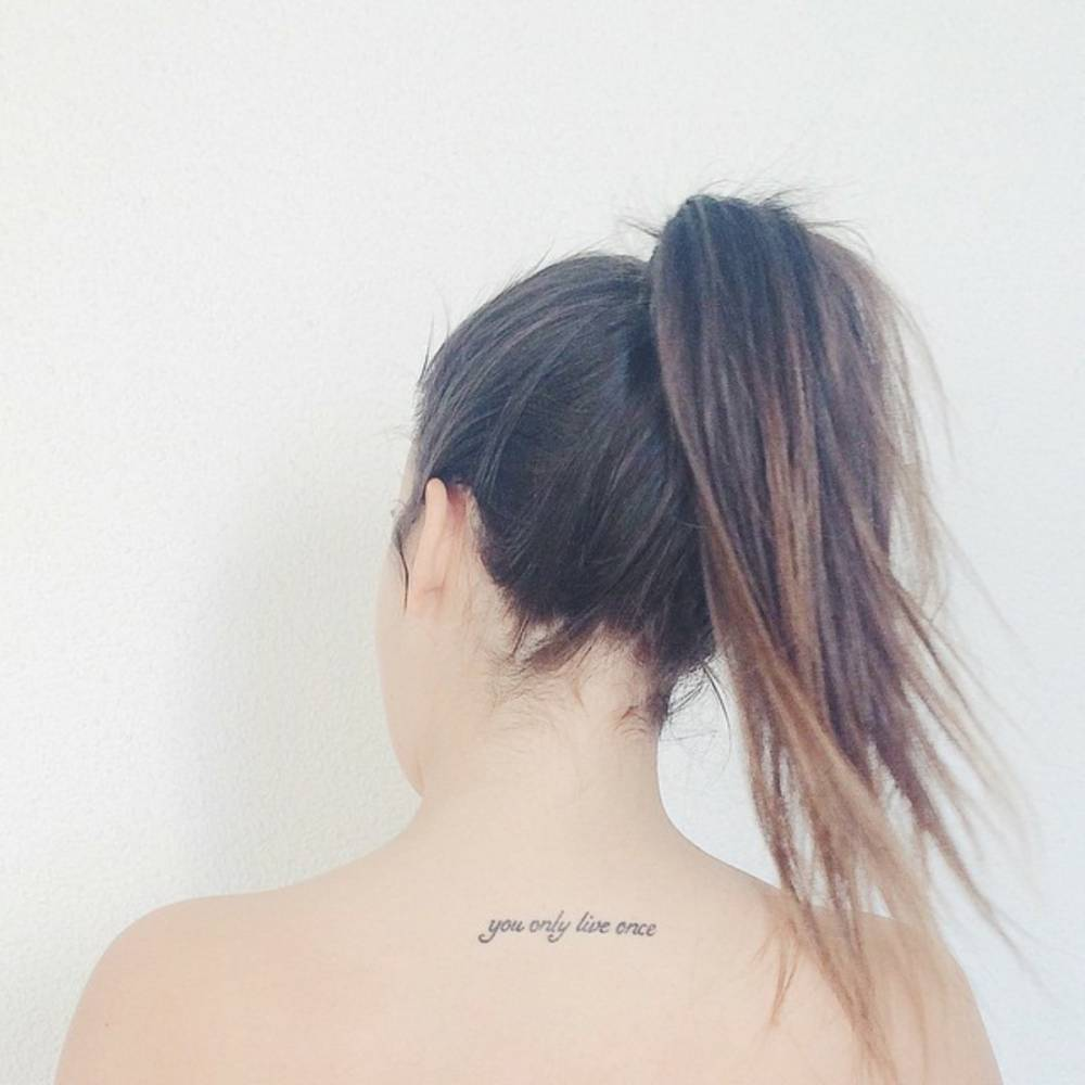 Upper Back Tattoo Saying You Only Live Once On