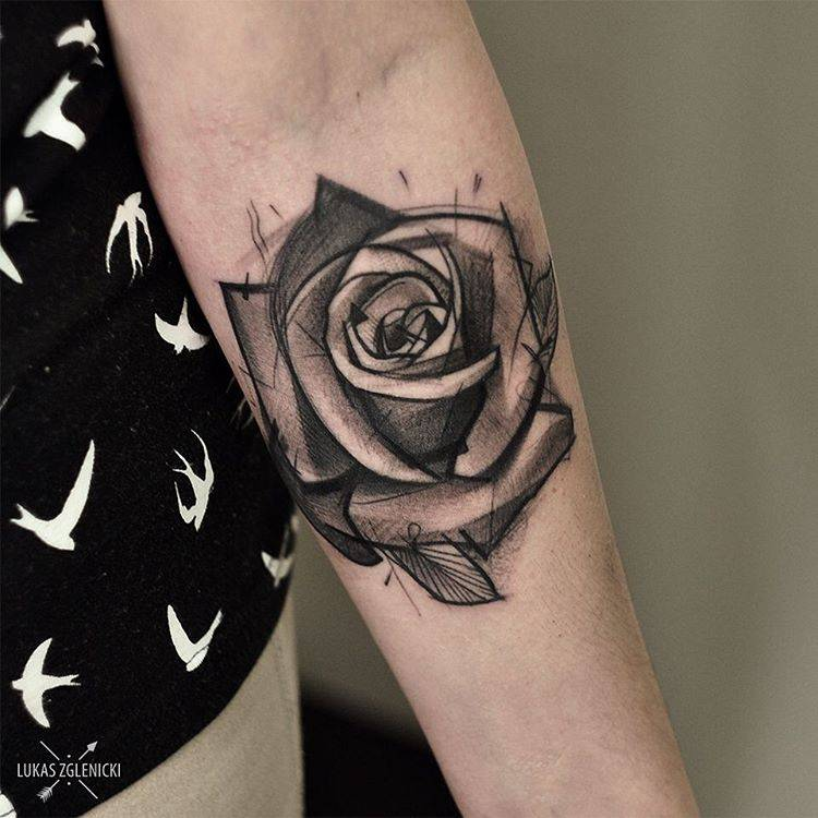 black rose tattoo on the left forearm.