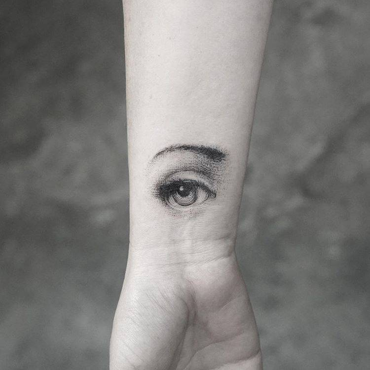 Fornasetti eye tattoo on the inner wrist.
