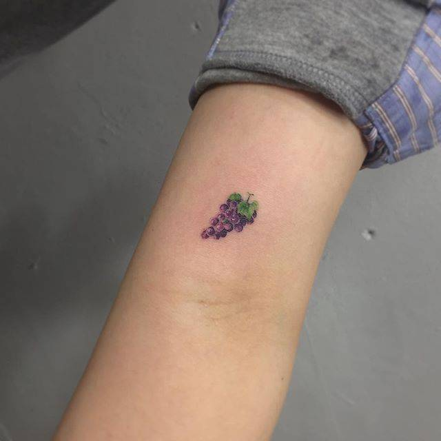 Grape tattoo on the bicep.